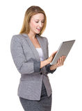 Business woman use of tablet Stock Images