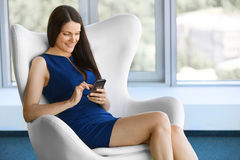 Business woman uses cell phone at office. Business people Stock Photos