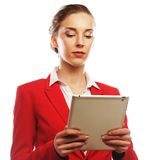 Business woman uses a mobile tablet computer Stock Photos