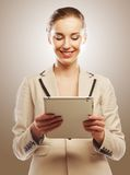 Business woman uses a mobile tablet computer Royalty Free Stock Photo