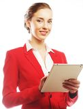 Business woman uses a mobile tablet computer Royalty Free Stock Photos
