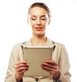 Business woman uses a mobile tablet computer Royalty Free Stock Images