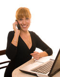 Business Woman Uses Phone And Laptop Stock Photo