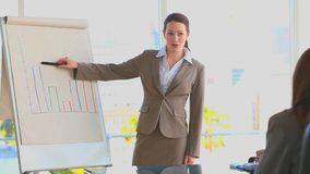 Business woman using a blackboard stock video