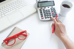 Business woman using calculator and laptop computer on white Royalty Free Stock Photo