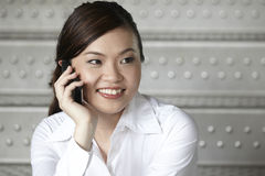 Business woman using a cell phone Royalty Free Stock Image
