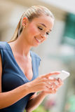 Business woman using cell phone Royalty Free Stock Image