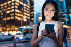 Business woman using cellphone in the city of Hong Kong Stock Images