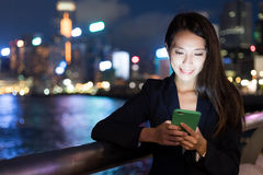 Business woman using cellphone in Hong Kong city. Asian young woman Stock Photo
