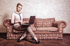 Business. Woman using computer at home Royalty Free Stock Images