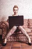 Business woman using computer. Internet home technology. Vintage photo. Royalty Free Stock Images