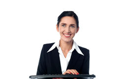 Business woman using computer keyboard. Beautiful young lady typing on a keyboard Royalty Free Stock Image