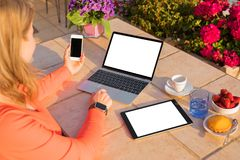 Woman using different tech devices royalty free stock photo