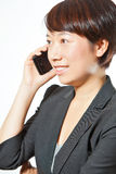 Business woman using her cell phone Stock Photography