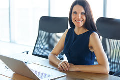 Business Woman using her Laptop Computer at office. Business Peo Royalty Free Stock Images
