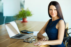 Business Woman using her Laptop Computer at office. Business Peo Stock Image