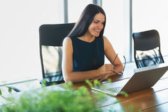 Business Woman using her Laptop Computer at office. Business Peo Royalty Free Stock Image