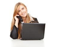 Business woman using her mobile phone and laptop Royalty Free Stock Photography