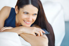 Business Woman Using Her Smartphone at The Office Stock Photo