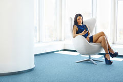 Business Woman Using Her Smartphone at The Office. Business Peop Stock Image