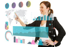 Business woman using infographic on touchscreen. Business woman using infographic on a big virtual touchscreen stock photos