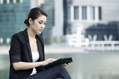 Business woman using an iPad Stock Photography