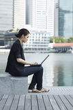 Business woman using a Laptop Stock Photography