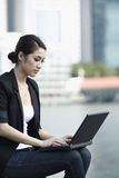 Business woman using a Laptop Stock Image