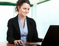 Business woman using laptop Stock Image