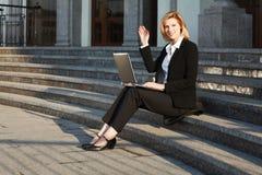 Business woman using laptop Stock Image