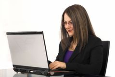 Business woman using laptop. Smiling business woman using laptop Royalty Free Stock Photos