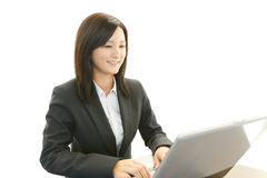 Business woman using laptop Royalty Free Stock Photography