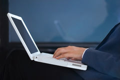 Business woman using laptop computer on blue background Royalty Free Stock Photography