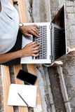 Business woman using laptop computer outdoors. Image of a beautiful business woman using laptop computer outdoors stock images