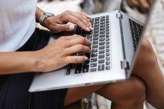 Business woman using laptop computer outdoors. Image of a beautiful business woman using laptop computer outdoors stock photos