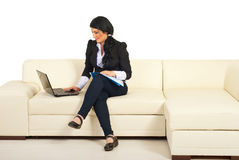 Business woman using laptop on couch Stock Photos