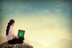 Business Woman Using Laptop On The Mountain Stock Image