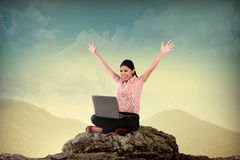 Business Woman Using Laptop On The Mountain Royalty Free Stock Image