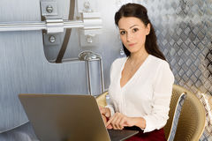 Business woman using laptop at office Stock Photo