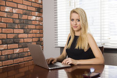Business woman using laptop at office Royalty Free Stock Photo