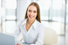 Business woman using laptop at office Stock Image