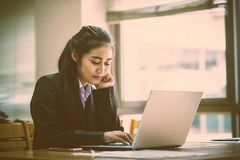 Business woman using laptop in office royalty free stock photography