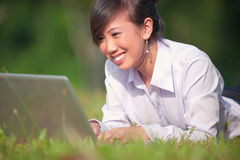 Business woman using laptop outdoor Stock Photos