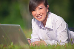 Business woman using laptop outdoor Royalty Free Stock Image