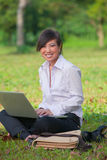 Business woman using laptop outdoor Stock Photo