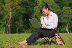 Business woman using laptop outdoor Royalty Free Stock Photo