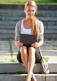 Business woman using laptop outdoors Royalty Free Stock Photos