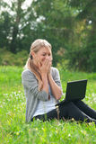Business woman using laptop outdoors Stock Image