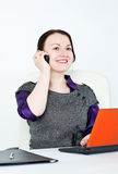 Business woman using laptop and phone Royalty Free Stock Images
