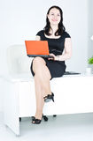 Business woman using laptop sitting on the table Stock Images